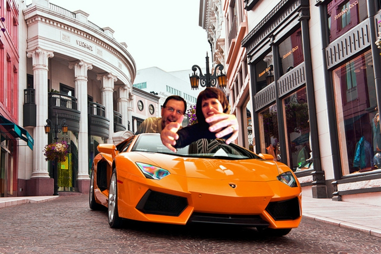 parents-hug-sportscar-rodeo-drive